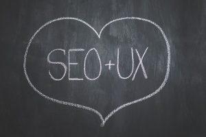 Dibujo de un corazón en cuyo interior pone SEO+UX en representación de una mejora del posicionamiento web seo